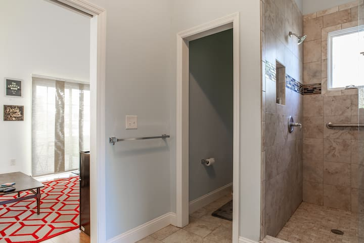 The toilet doesn't have a door but both sides of the bathroom does! Keeps the space open.