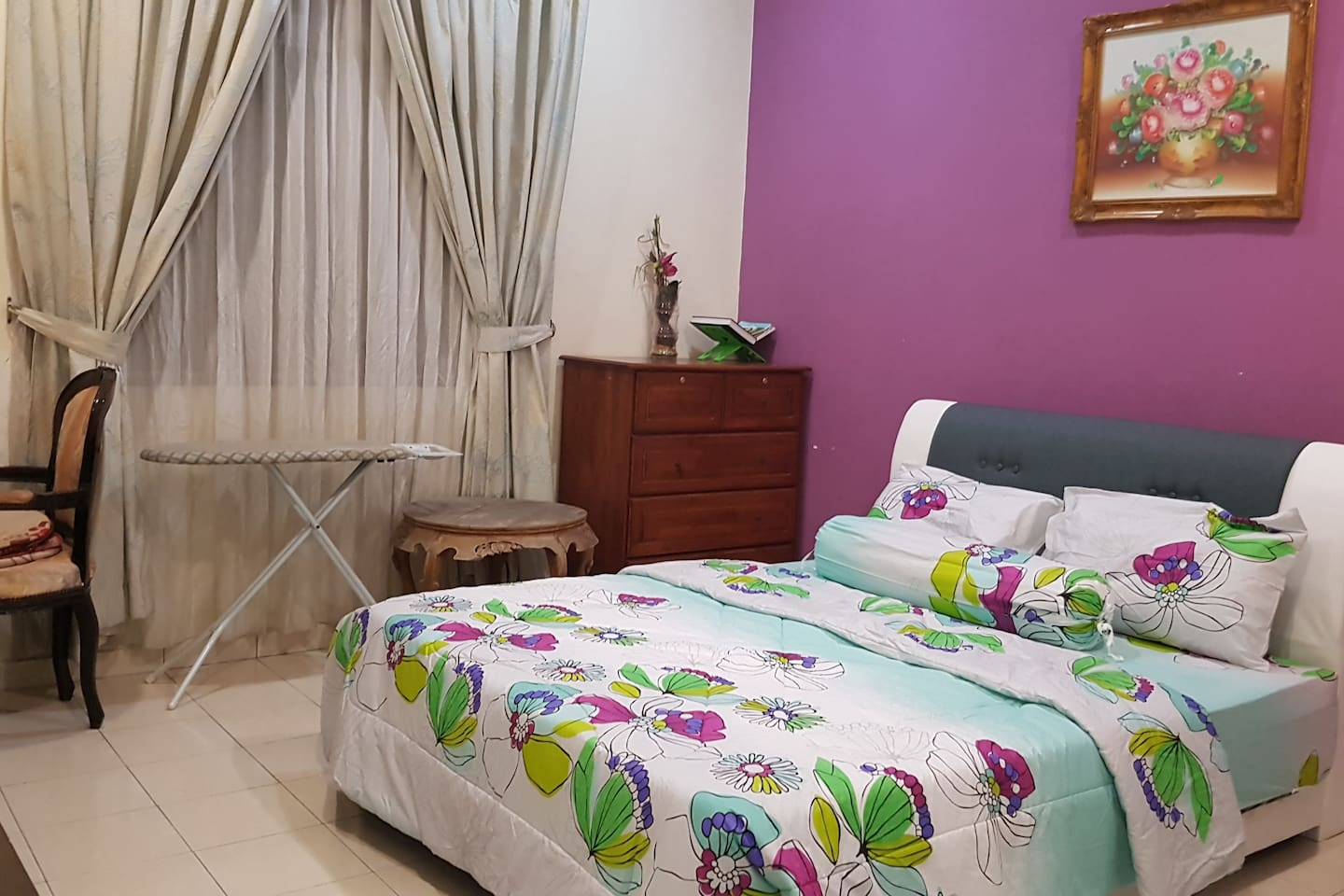 """The master bedroom is very spacious, filled with a queen size bed, a drawer table, 29"""" TV and a table/chair as workstation"""