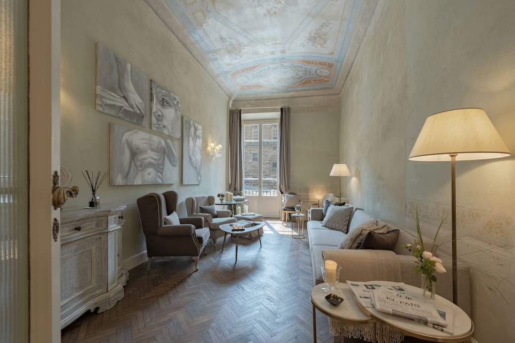 The beautiful living room which offers gorgeous views onto Piazza Pitti.