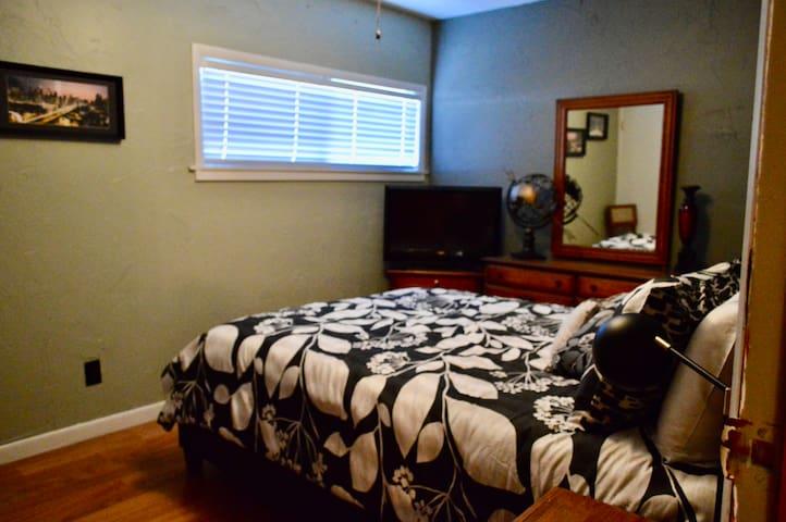 Bedroom 1. Queen bed, closet, HDTV.