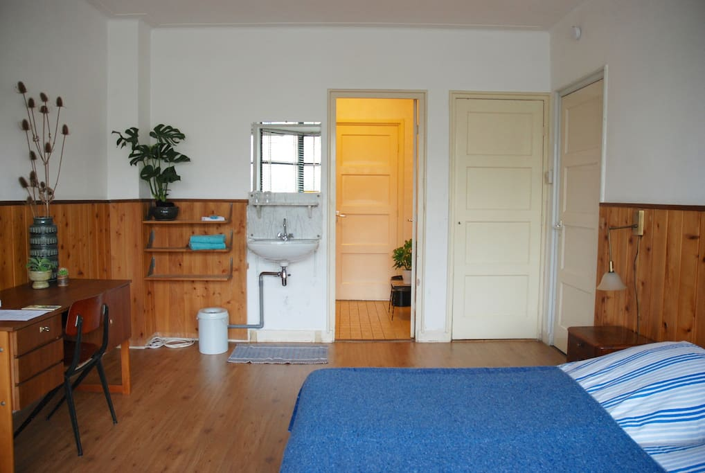 Bedroom with shared bathroom