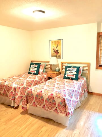 Another main floor bedroom with twin beds
