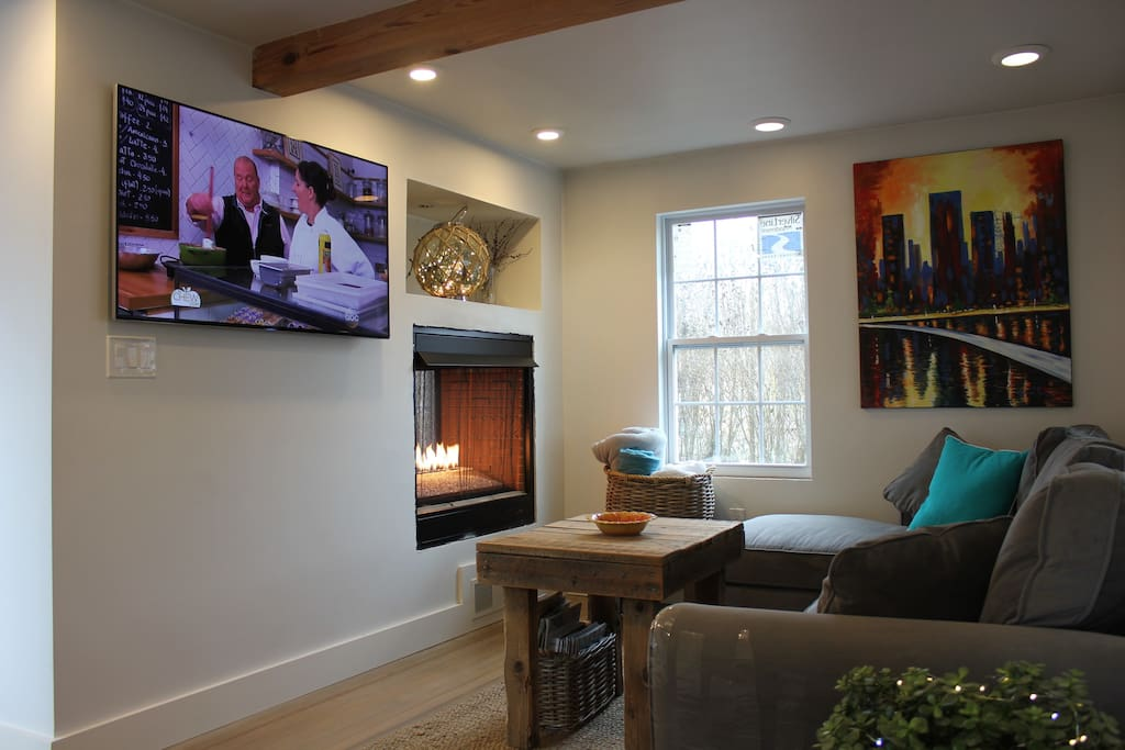 Inviting living room with see through fireplace