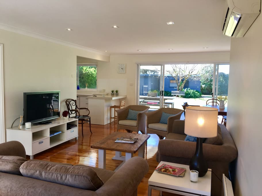 Open family lounge, kitchen, dining which all opens up to a large north facing deck and lawn backyard