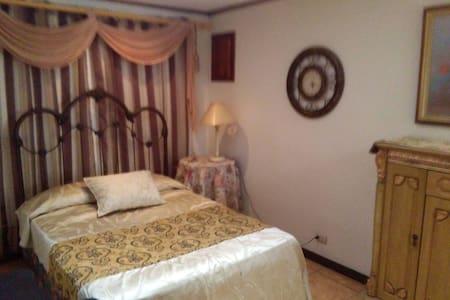 Habitación en una casa Cama cómoda - San Isidro cantón 11  - Hus