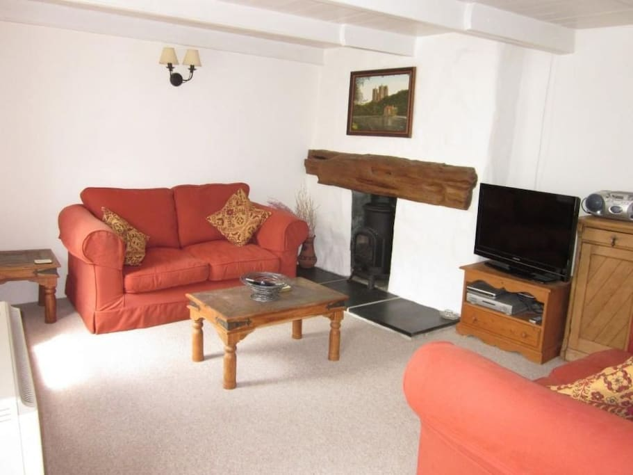 Cosy sitting room with 2 sofas, TV, gas stove