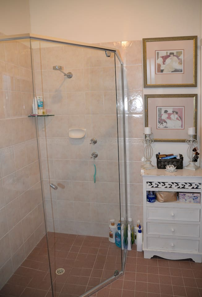 The bathroom is clean and bright. It has a bath, shower and there is a separate toilet. Bathroom towels, soap, body wash, shampoo and conditioner are also provided.