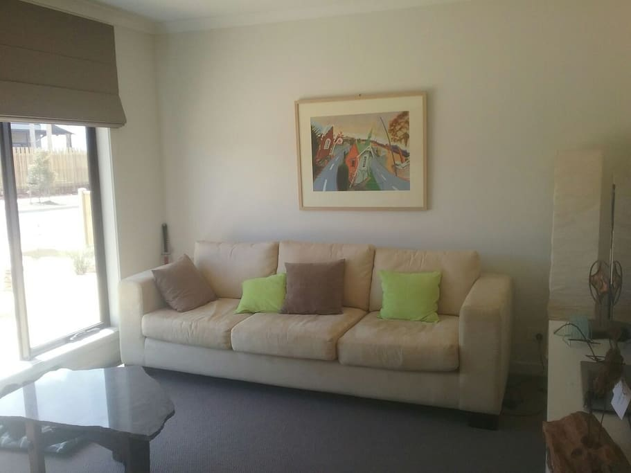 lounge room at the front of house . Sunny spot in the mornings