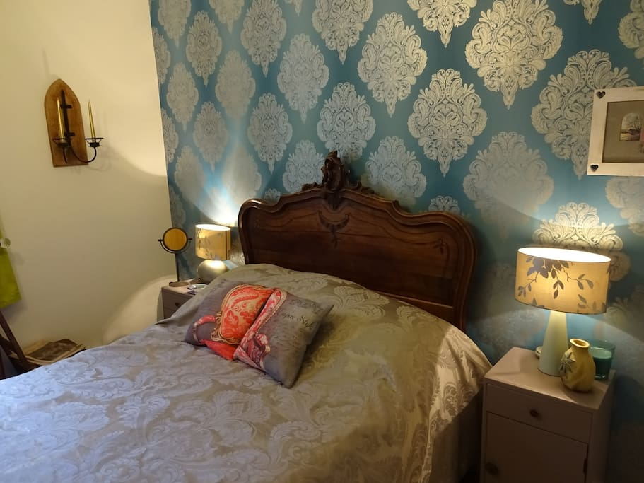 Ground floor French themed bedroom with Genuine 18th century French bed with modern mattress an foam topper