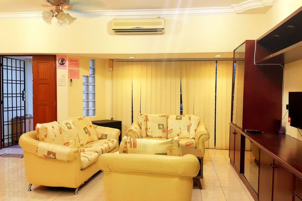*Spacious living hall with fully  air-conditioned and ceiling fan. *comfortable sofa.