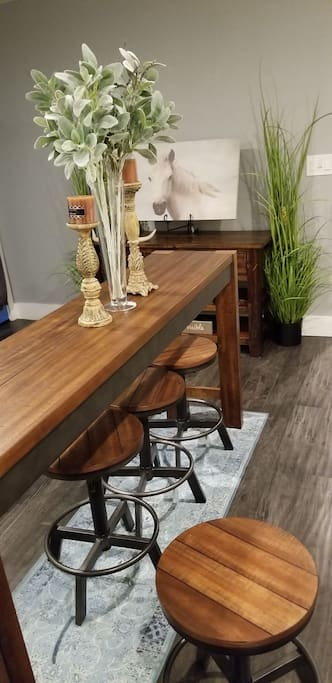Beautiful custom made  dining table with 4 stools.