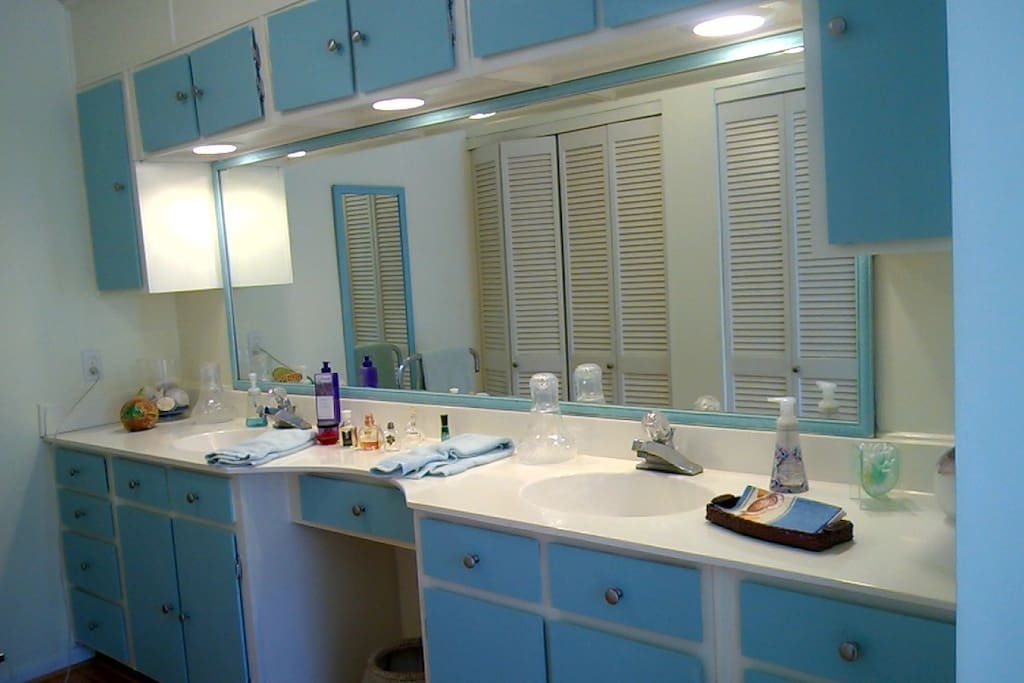 Double sink counter in bathroom.