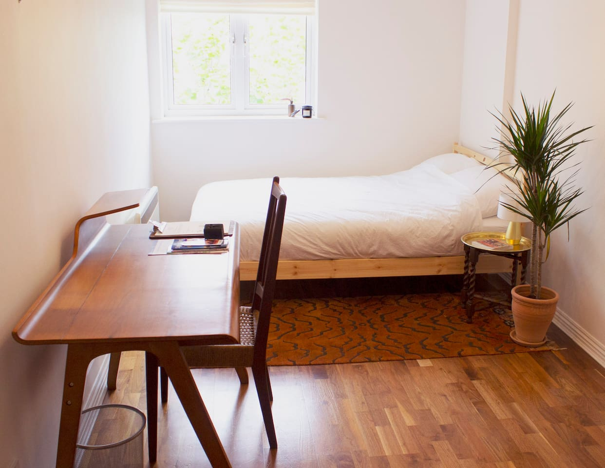 Double bed / full body mirror / desk and chair / bedside table and lamps / wardrobe / hairdryer/ adaptor / tourist information