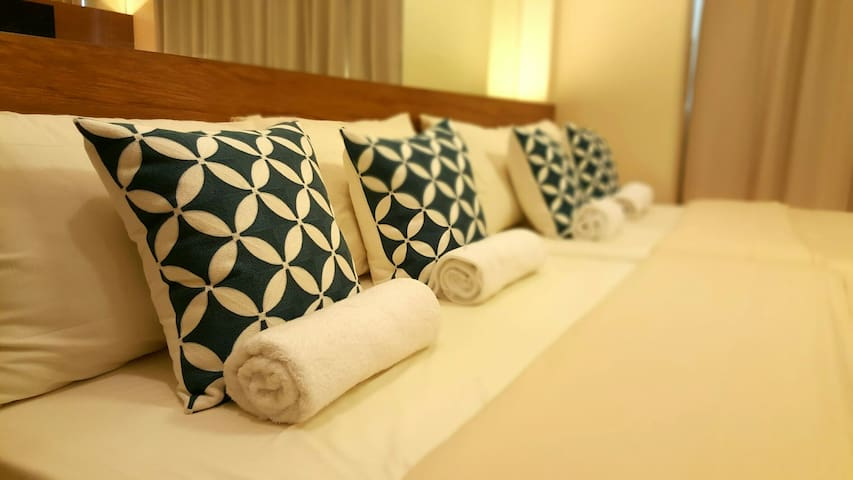 Fresh towels are provided for the guests