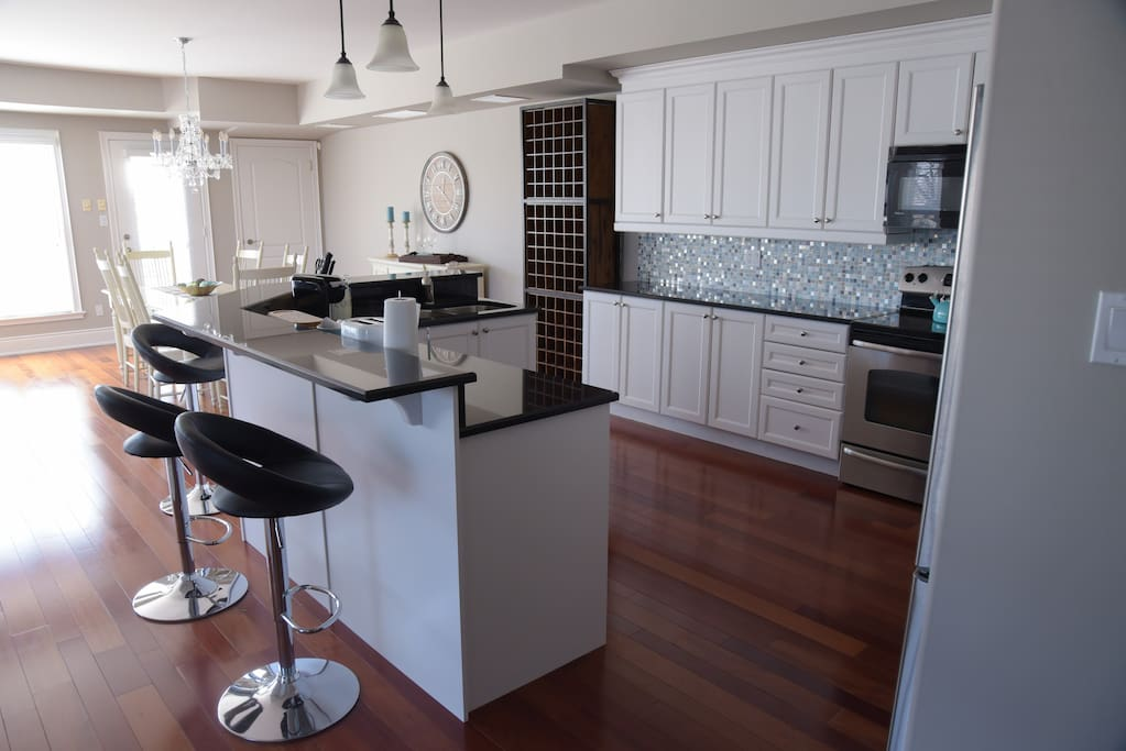 Gourmet full size kitchen with sit-up bar overlooking beautiful Lake Ontario