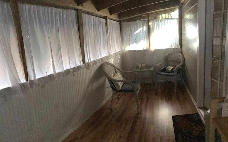 This is half of the attached screened-in porch.