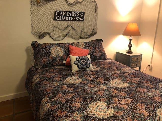 The captain's quarters has a new Queen bed and bedding. Get a great nights sleep in Private in this second bedroom.
