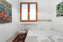 The second Bedroom - The comfortable double bed with soft bed-linen and towels