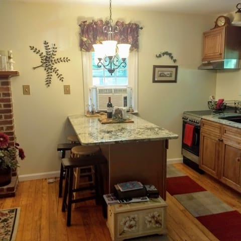 Fully stocked kitchen with granite counter top and air conditioning.