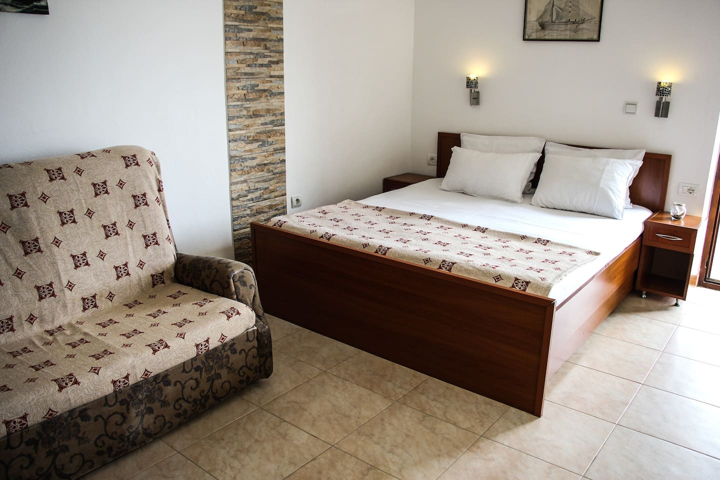 This is a studio apartment. It is a great room for couples, it has a wonderful view of the small beach and part of the old town. The room has a living room area, kitchen, bathroom, terrace, AC and satelite TV. Free parking and Wi-Fi is available to all our guests. This room perfectly describes the style of Ulcinj homes, it is cozy, comfortable, simple and welcoming!
