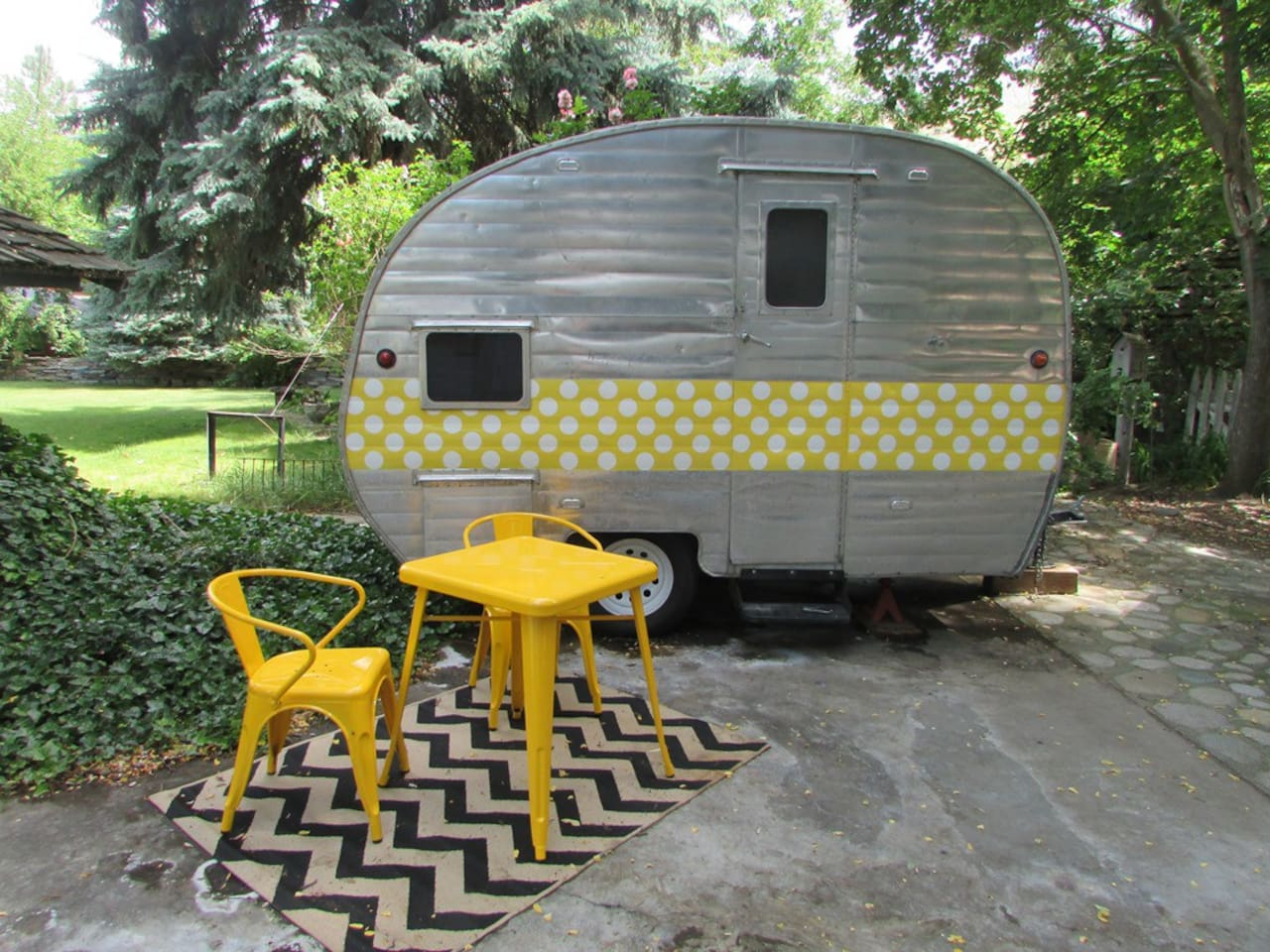 The Vintage Aloha 1956 Camper is located in Mavens' Haven's vintage trailer court.