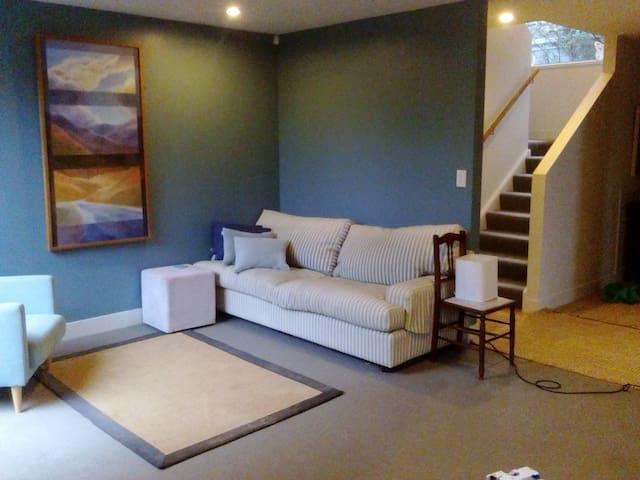Leafy, modern, warm, house.