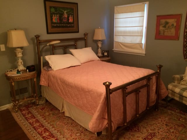 Master bedroom with regular sized, extra firm mattress