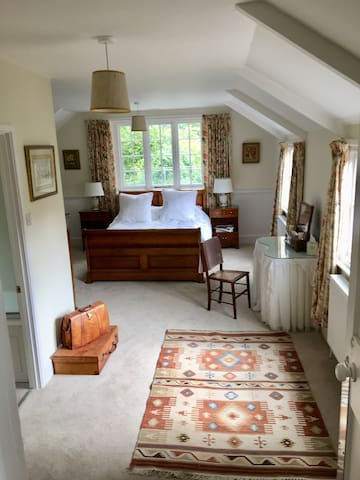 Your bedroom with windows overlooking the tennis court and the courtyard.