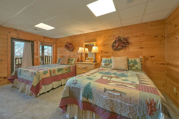 Bunk up in this cozy downstairs bedroom with 2 Queen beds and private bathroom.