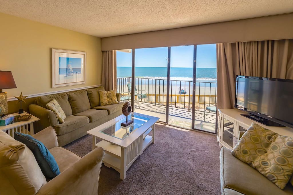 Enjoy TV or the ocean view in this comfortable living room.
