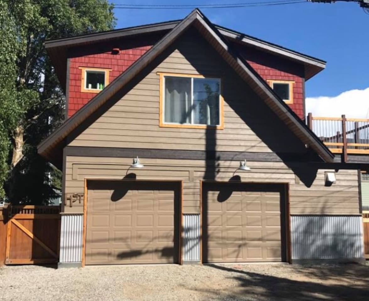 1 bedroom apartment with a deck above a garage.