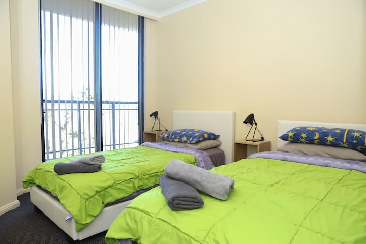 Two comfortable single beds with medium-firm mattresses in Bedroom 2.