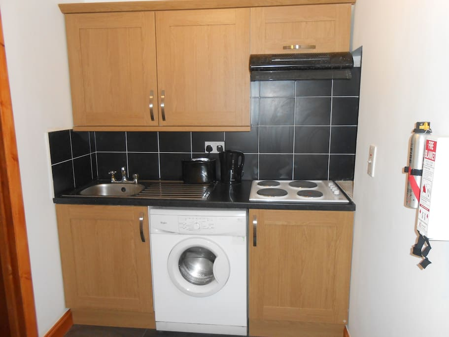 Fully equipped kitchen.  Washing machine, Fridge/Freezer, Mirowave all included.