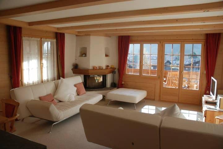 Gstaad wraparound balcony with alpine view
