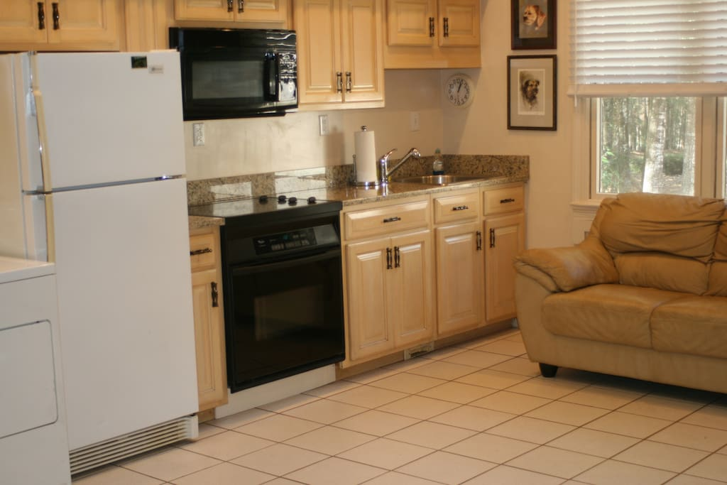Fully equipped kitchen with pots pans, dishes just like home.