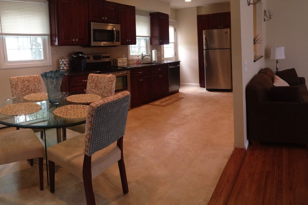 Full kitchen with All New appliances. Oven with cooktop, Microwave, Dishwasher and full size Refrigerator.