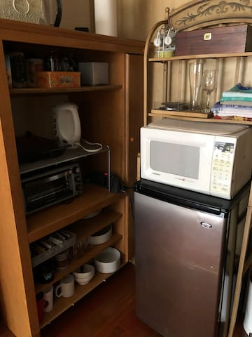 refrigerator, microwave, toaster & induction unit, coffee press, electric kettle