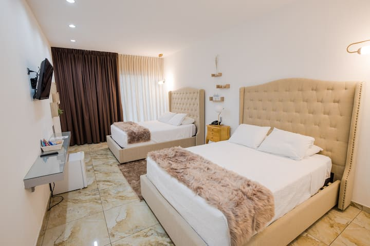 Bedroom 2 Queen-size beds at Hotel Las Americas 22