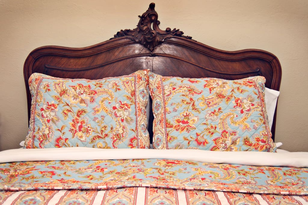 Each room is furnished with period antiques and original artwork