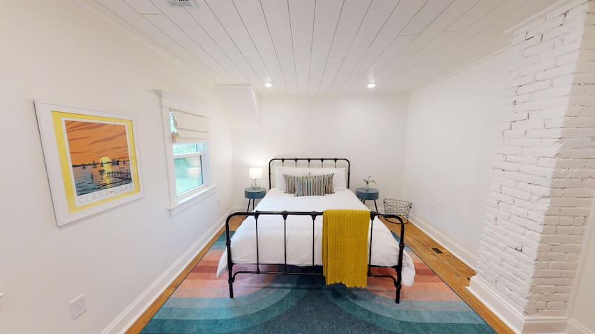 The third bedroom has a queen bed and blackout window treatments.