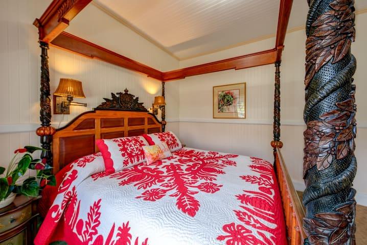 A royal ali'i koa wood bed in master bedroom is a duplicate of one in Hulihe'e Palace in Kona. Sleep like the kings!
