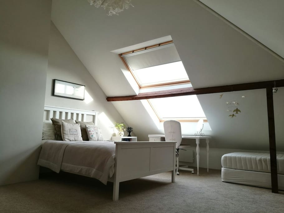 Spacious loft room (approx 35m2) sleeps up to 4 people.