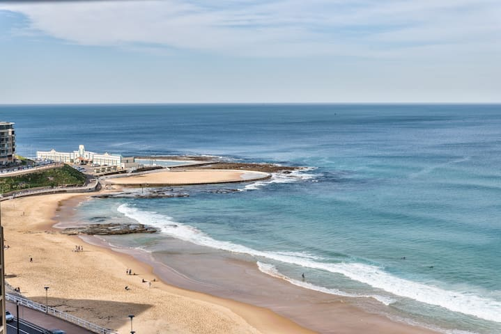 View from balcony - Newcastle Beach and Ocean Baths.