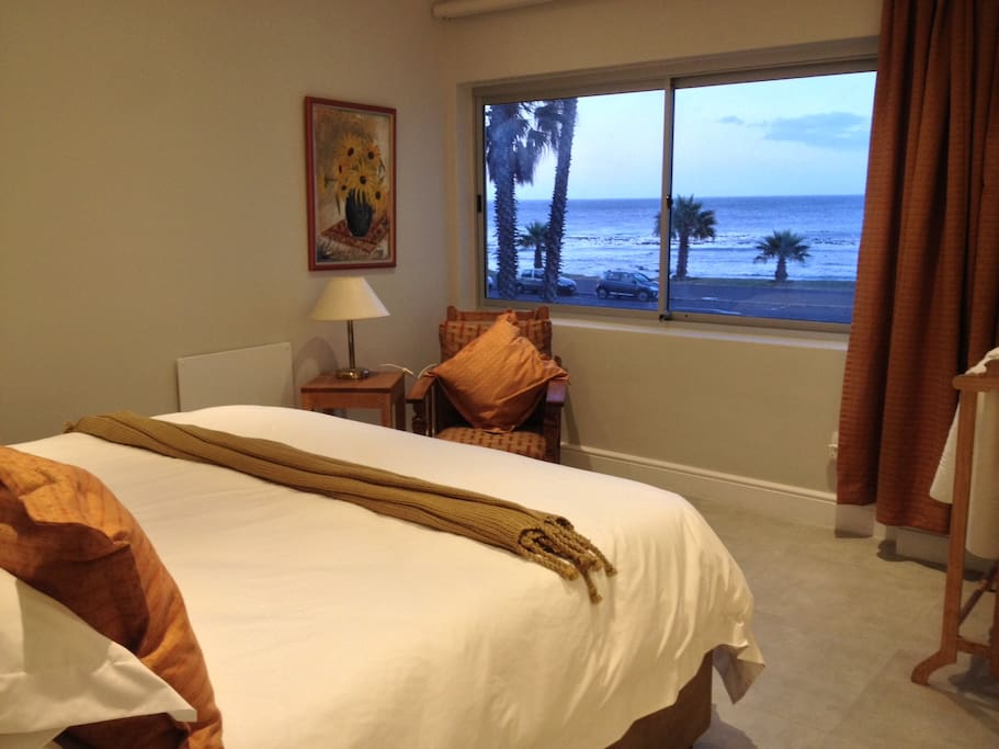 Spacious first bedroom with extra length king bed, separable into twins. View of Atlantic Ocean