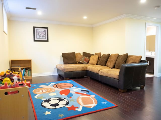 Basement recreational room with children's books and toys