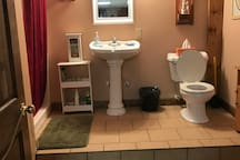 Private bathroom with shower, bath & dressing table.