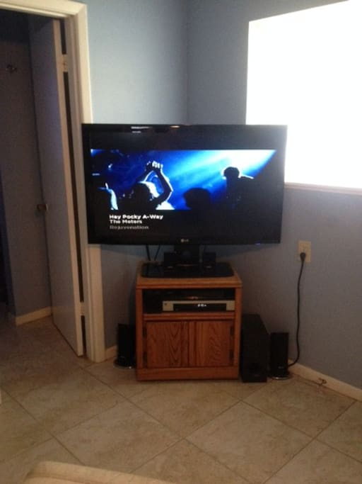 Large flat screen TV with cable in living room.