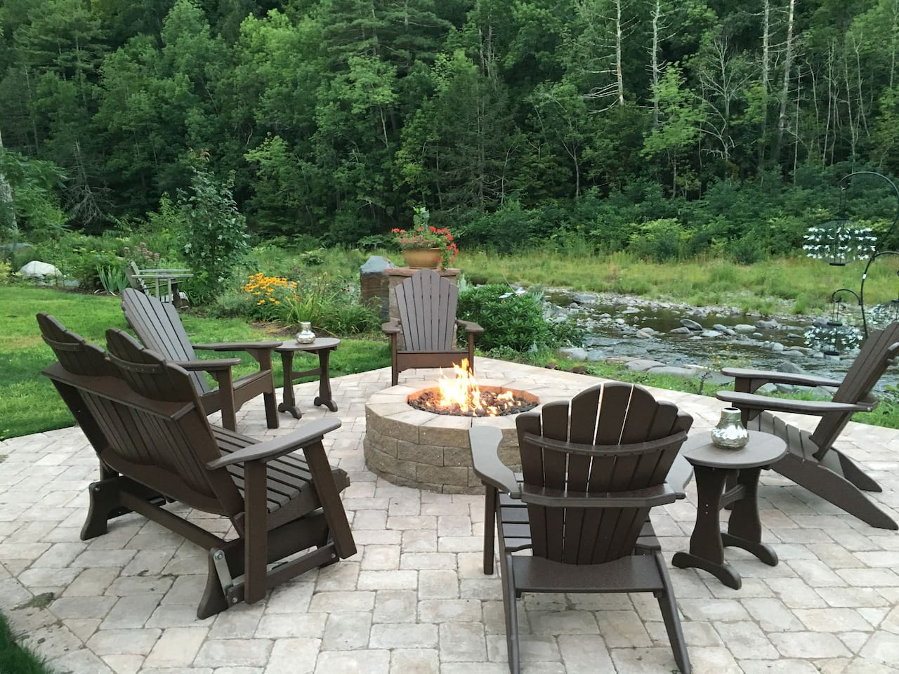 enjoy our beautiful, new, stream side patio with comfortable furniture & terrific seasonal fire pit