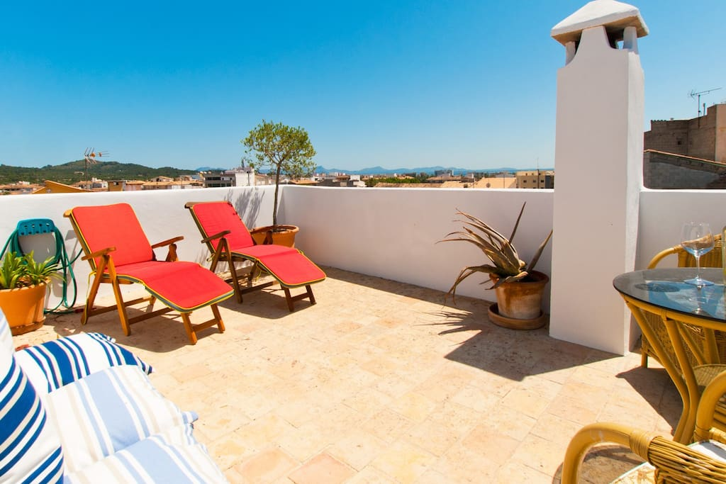 Roof terrace with views across the Bay of Pollenca and the Tramuntana mountains