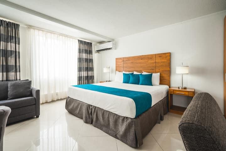 Junior Suite: 1 King Bed, Kitchen, & Beach Access